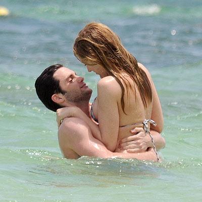 Girls bikinis kissing