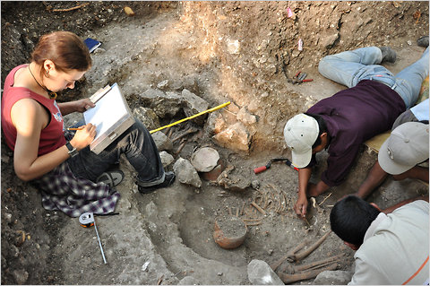Anastasia Kravtsova, left, and Q'eqchi' excavators working on burials.by takeshi inomate daniela triadan maya archaeology maya sit of ceibal Guatemala