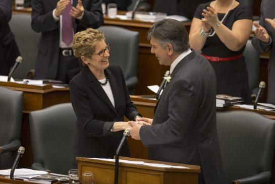 premiere liberal kathleen wynne with finance minister charles sousa budget may 2 2013 cutting benefits to odsp